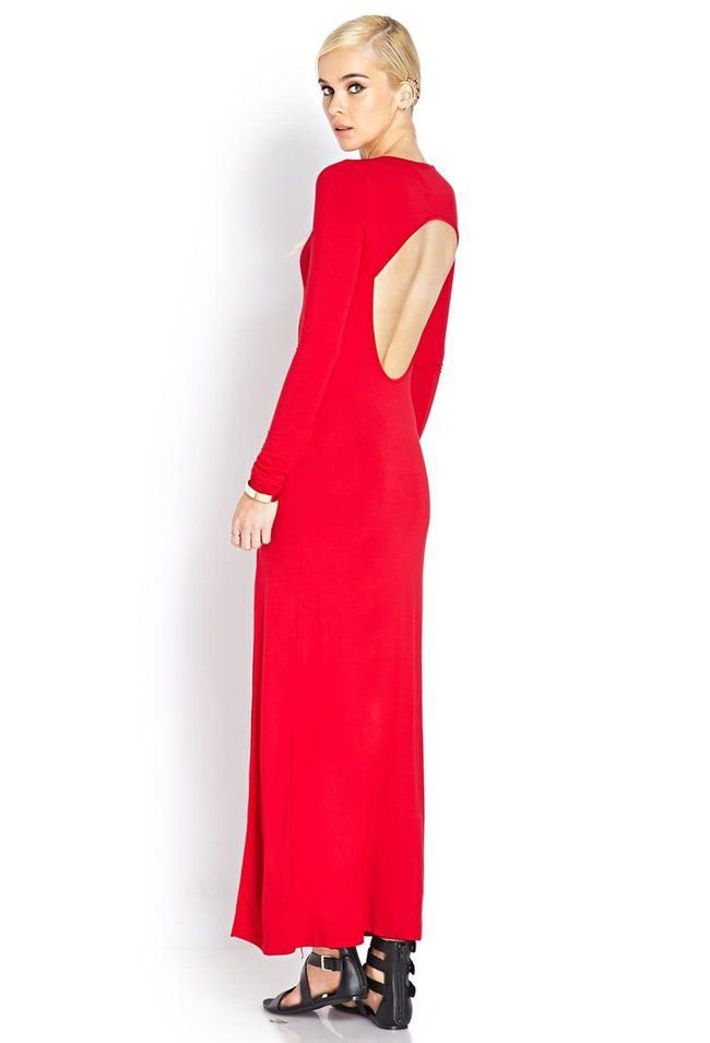 A maxi dress featuring a front slit. Scoop neckline. Long sleeves. Cutout back. Finished ends. Kn...
