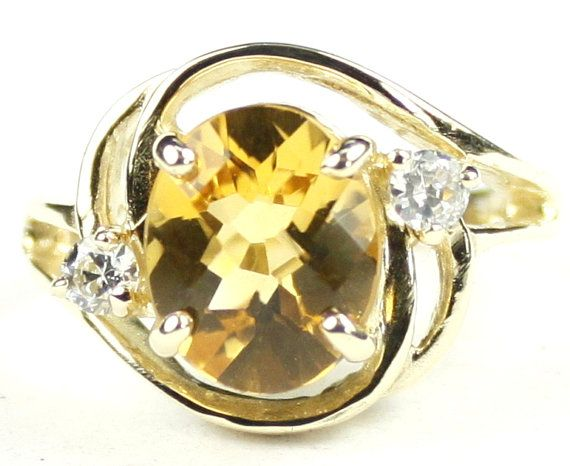 R021, Citrine, 10KY Gold Ring * Stone Type - Citrine * Approximate Stone Size - 10x8mm  * Approximate Stone Weight - 3.3 cts  * Jewelry Metal - Solid 10k Yellow Gold * Approximate Metal Weight - 3.9 grams  * Ring Size - Size selectable during checkout * Our Warranty - A full year on workmanship  * Our Guarantee - Totally unconditional 30 day guarantee