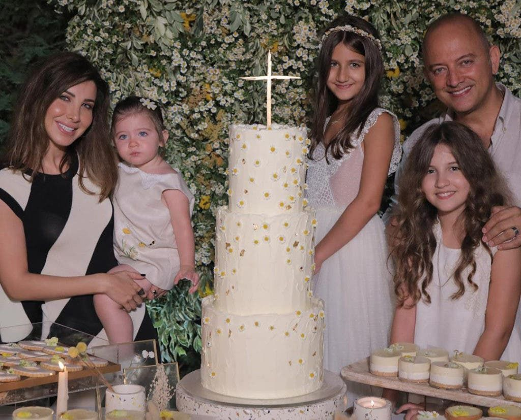 نانسي عجرم في عيادة زوجها فادي الهاشم قبل أكثر من 12 عاما صورة Graduation Dress Pillar Candles Dresses