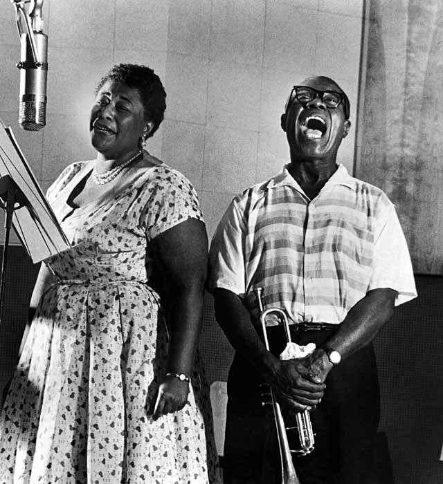 "Ella Fitzgerald and Louis Armstrong recording the album ""Ella and Louis,"" 1956. (© Phil Stern)"