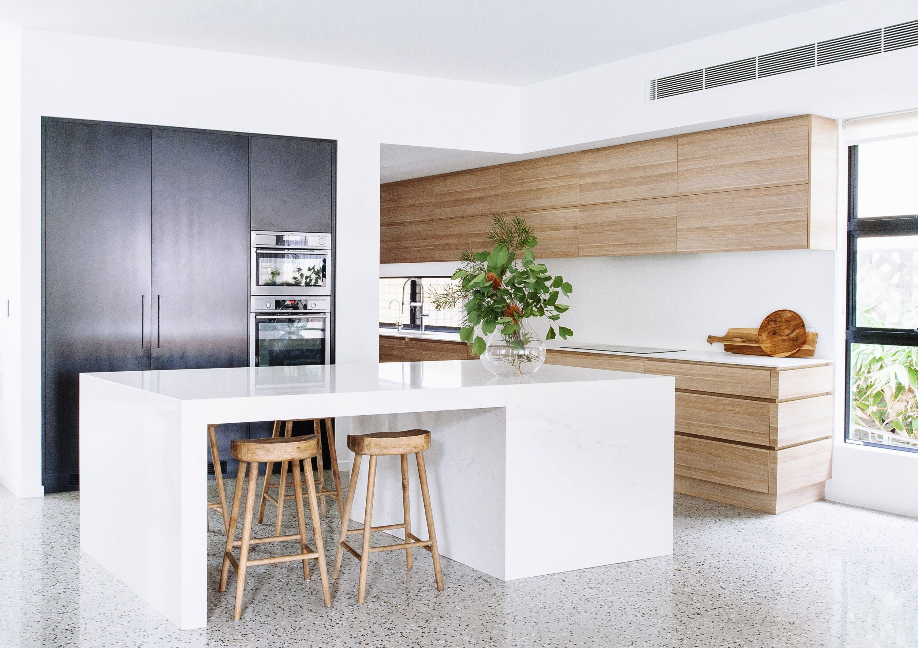 John campbell design colour blocked kitchen in narrow home