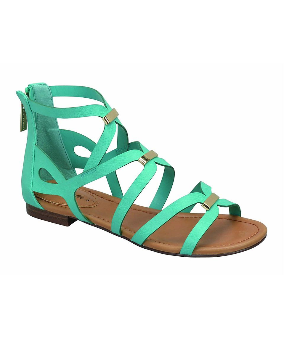 814a7566431 Crisscrossing straps define the grecian-inspired design of this sandal  sealed with a smooth back zip closure.