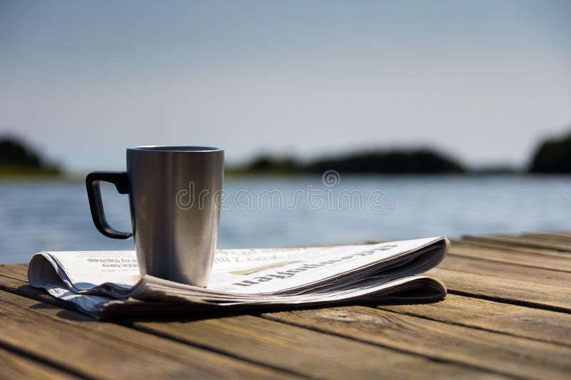 Morning At The Jetty A Sunny Morning At The Jetty With The Newspaper And A Cup Affiliate Sunny Jetty Morning Mornin Stock Photos Stock Images Image