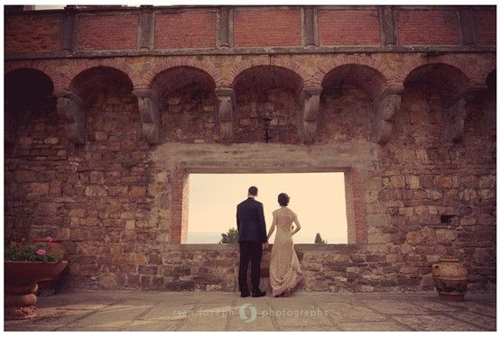 I love this whole series of bride and groom portraits!  They look totally alone in the castle and the photos blend the castle's beauty with theirs. I love it! :)