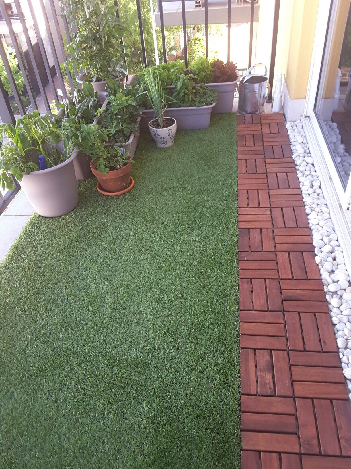 Balcony with artificial grass, decking and plants. Perfect