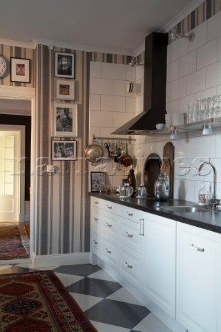 Kitchen Worktop With Laura Ashley Striped Wallpaper And Patterned Rug
