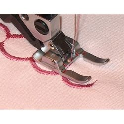 The Pfaff Open Toe Applique Foot is ideal for appliques as it has a groove on the underside to allow dense satin stitching to pass. The open toe provides excellent visibility for quilting or matching decorative stitches. The Pfaff Open Toe Applique Foot allows you to use the Dual Feed.