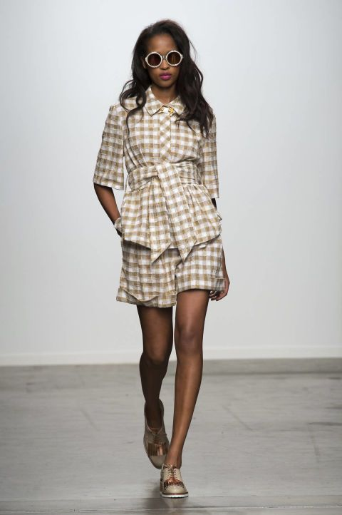 Gingham proved that it's here to stay for spring with designers splashing the checkered print on trench coats and shorts sets alike. Karen Walker