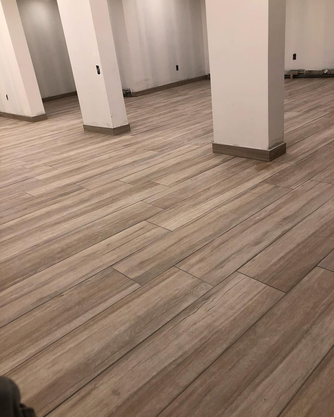 New The 10 Best Home Decor With Pictures 9x48 Porcelain Planks Put Down In This Basement Floor Woo With Images Basement Flooring Options Basement Flooring Flooring