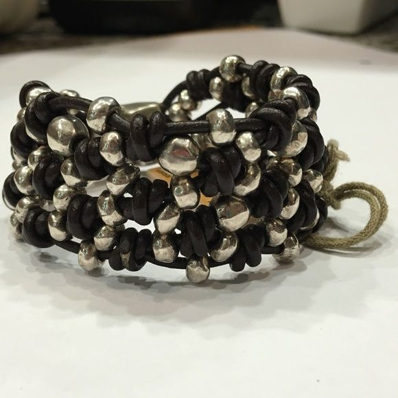 Uno de 50 bracelet Bracelet with various strands of knotted brown leather and intertwined silver-plated metal beads. Jewelry Bracelets