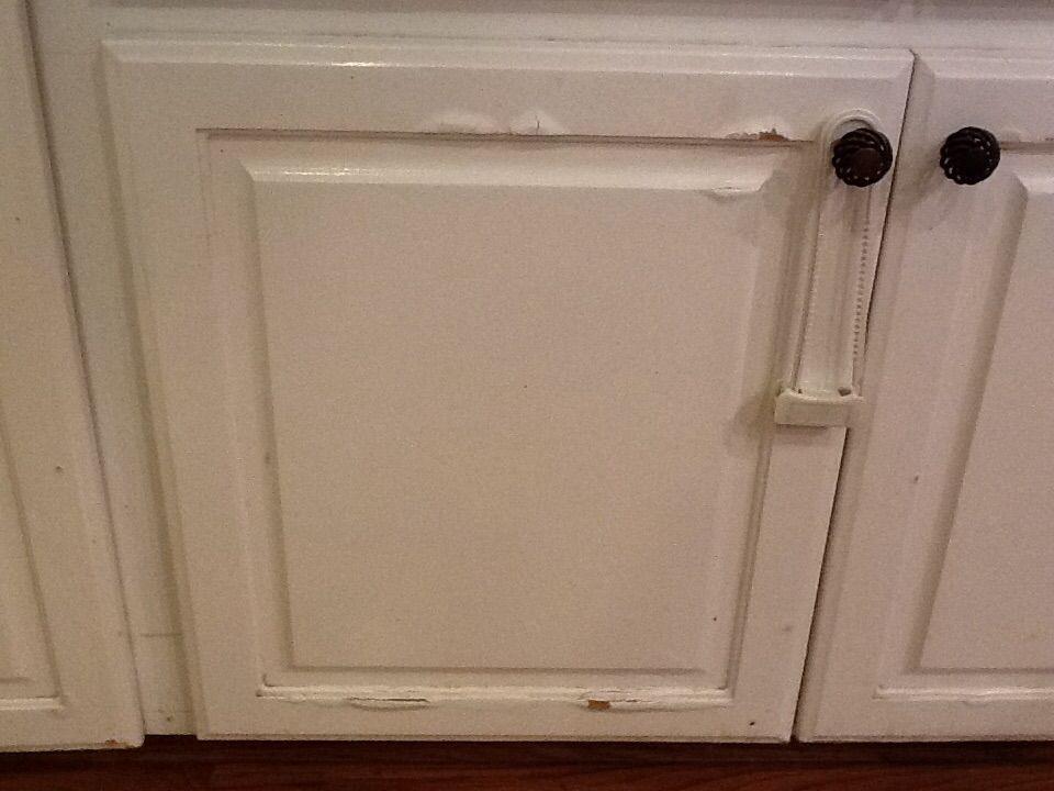 Water Damage On Press Wood Kitchen Cabinets