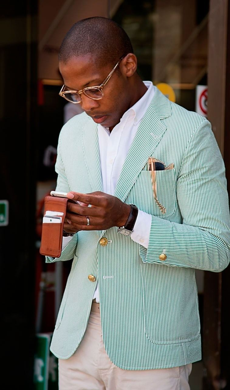Green seersucker; love it all, the gold buttons, both pairs of glasses, the wallet and his elegant hands.