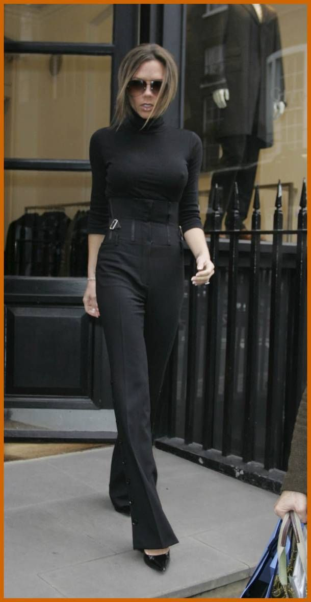 9331b31566ee1 Victoria Beckham  Flared black trousers + fitted turtleneck. Classic ...