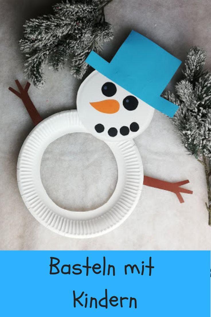 Mit Kindern basteln: Schneemänner aus Papptellern