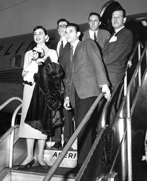 Audrey, Richard Avedon, director Stanley Donen, screenwriter Leonard Gershe & producer Roger Edens arriving in Paris to film Funny Face, 1956.