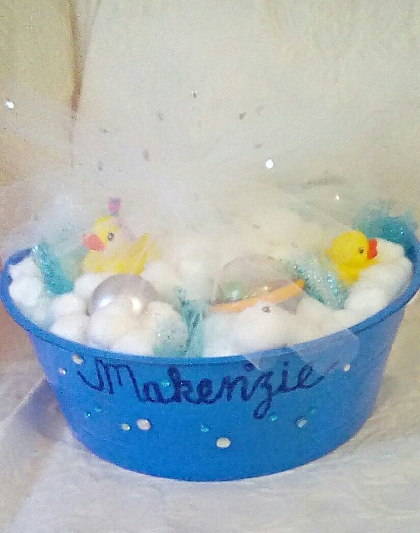 "New baby diaper gift-I put diapers in the decorated tub and covered with cotton ball and toy ""bubbles"" before adding duckies and a bow."