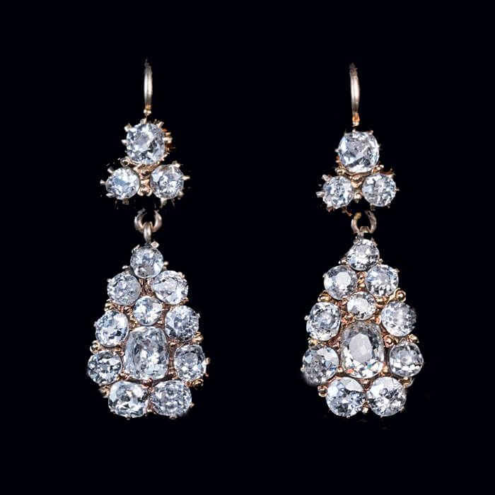 Antique Russian Diamond Drop Earrings, Odessa, 1908-1917. Crafted in 14K gold and prong set with 3 carats of bright white and sparkling antique cushion cut and old European cut diamonds.