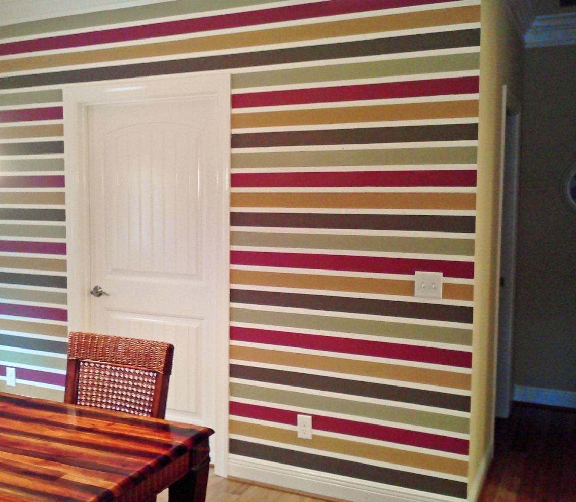 Painted striped accent wall walls are a buttery golden for Accent stripe wall