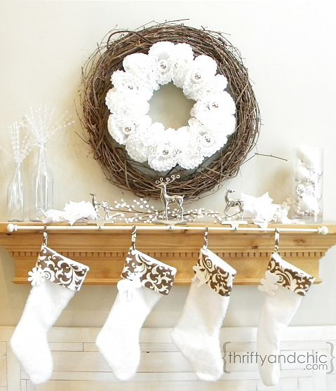 A great idea for hanging a bunch of Christmas stockings. A curtain rod.