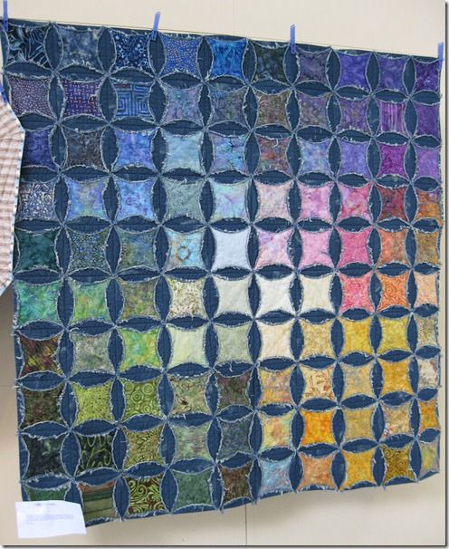 Another faux cathedral windows quilt, denim circles with batik inside - lovely!