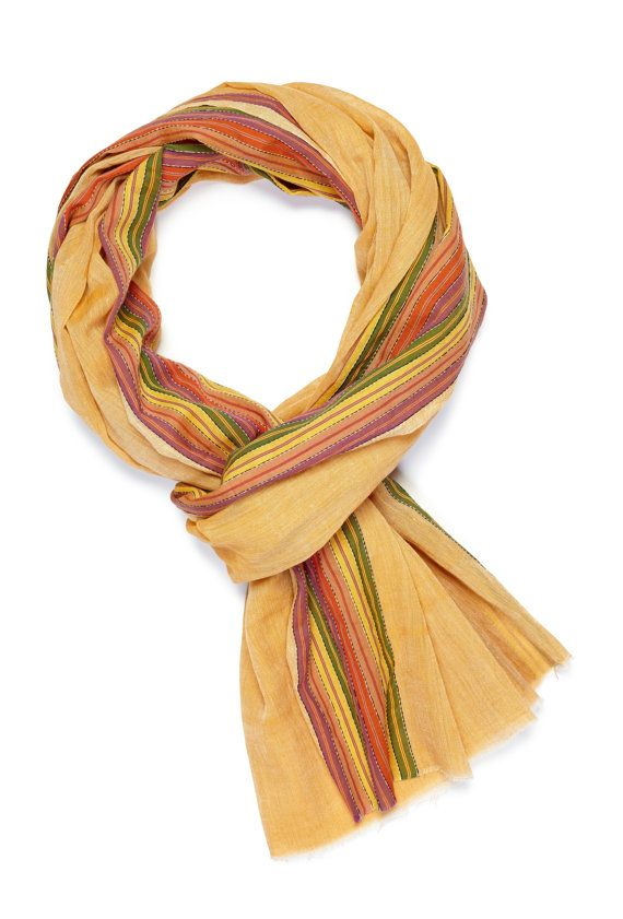 This scarf calls us to the beach, which is why we named it Playa. Handwoven in a warm orange with stripes of all your favorite Summer colors