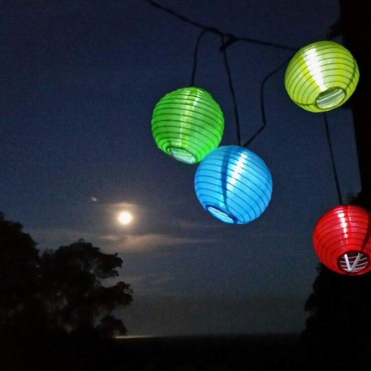 Birthday lanterns and full moon over Buckombil Mountain