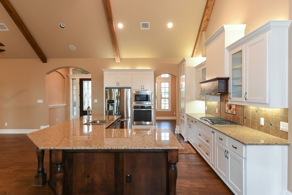 Traditional Kitchen with Exposed beam, Stone Tile, Custom hood, Glass panel, High ceiling, European Cabinets, Hardwood floors