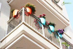 modern, sleek saddle planter for balconies and railings, indoors and out . Blue plant pot fence /railing