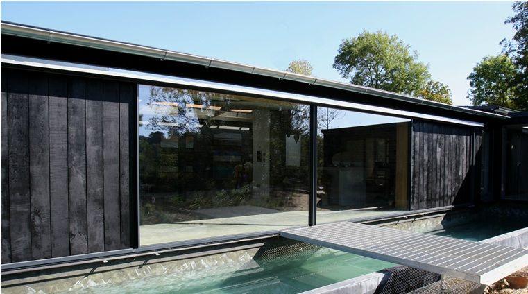 External Pocket Door minimal windows sliding doors to modern barn conversion to filling