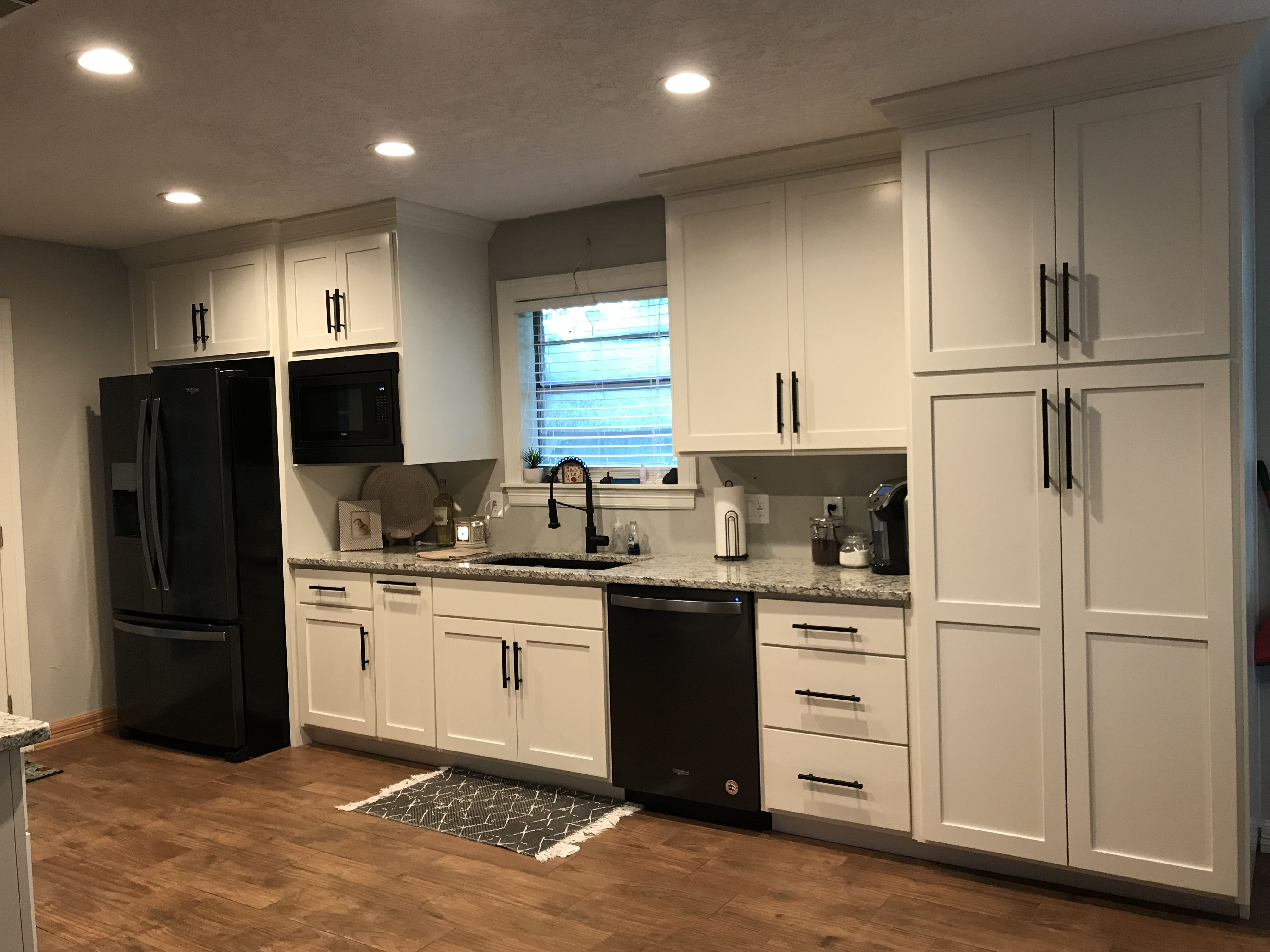 Sherwin Williams Alabaster kitchen with black