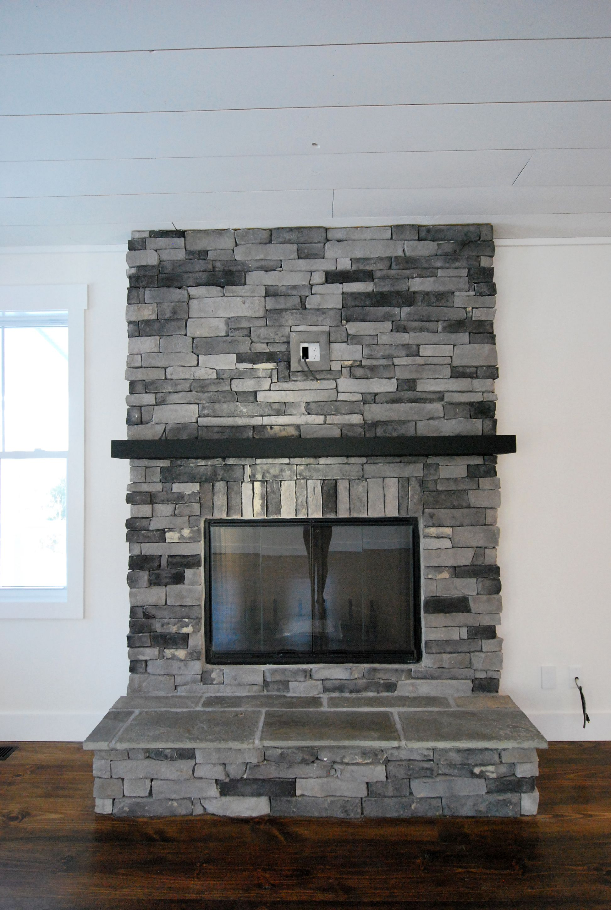 A Not So Typical Dark Mantel To Accent A Gray Toned Fireplace At