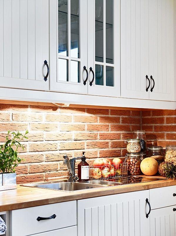 Brick Backsplash With White Cabinets