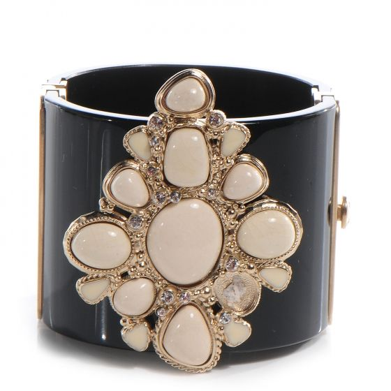 This is an authentic CHANEL Resin Crystal Cabochon Cuff in Black.