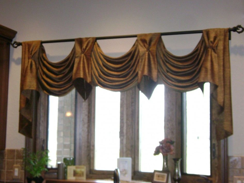 Scalloped valance with tab overlay in complimentary fabric High ceiling curtain ideas