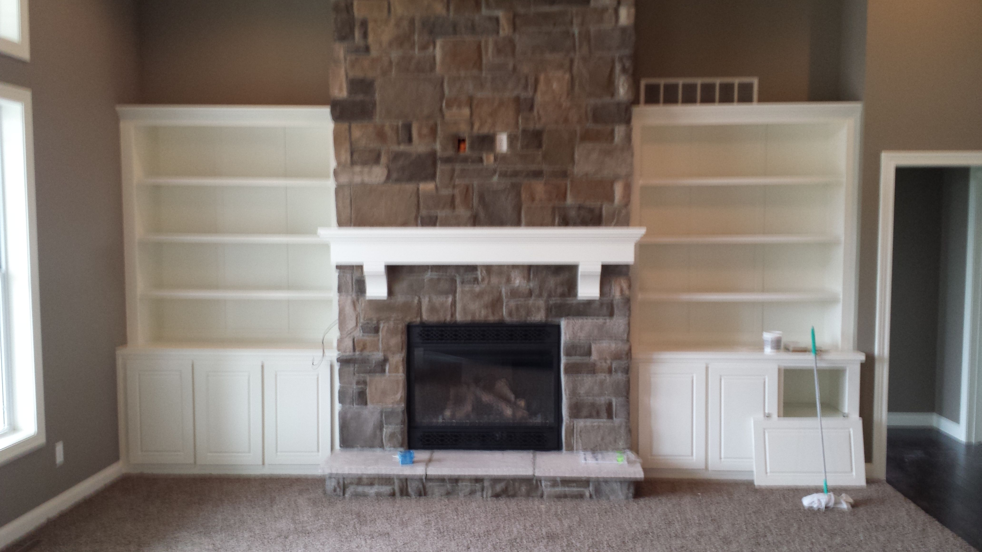 Custom Wood Built Ins Around Fireplace With Shelving And Cabinets