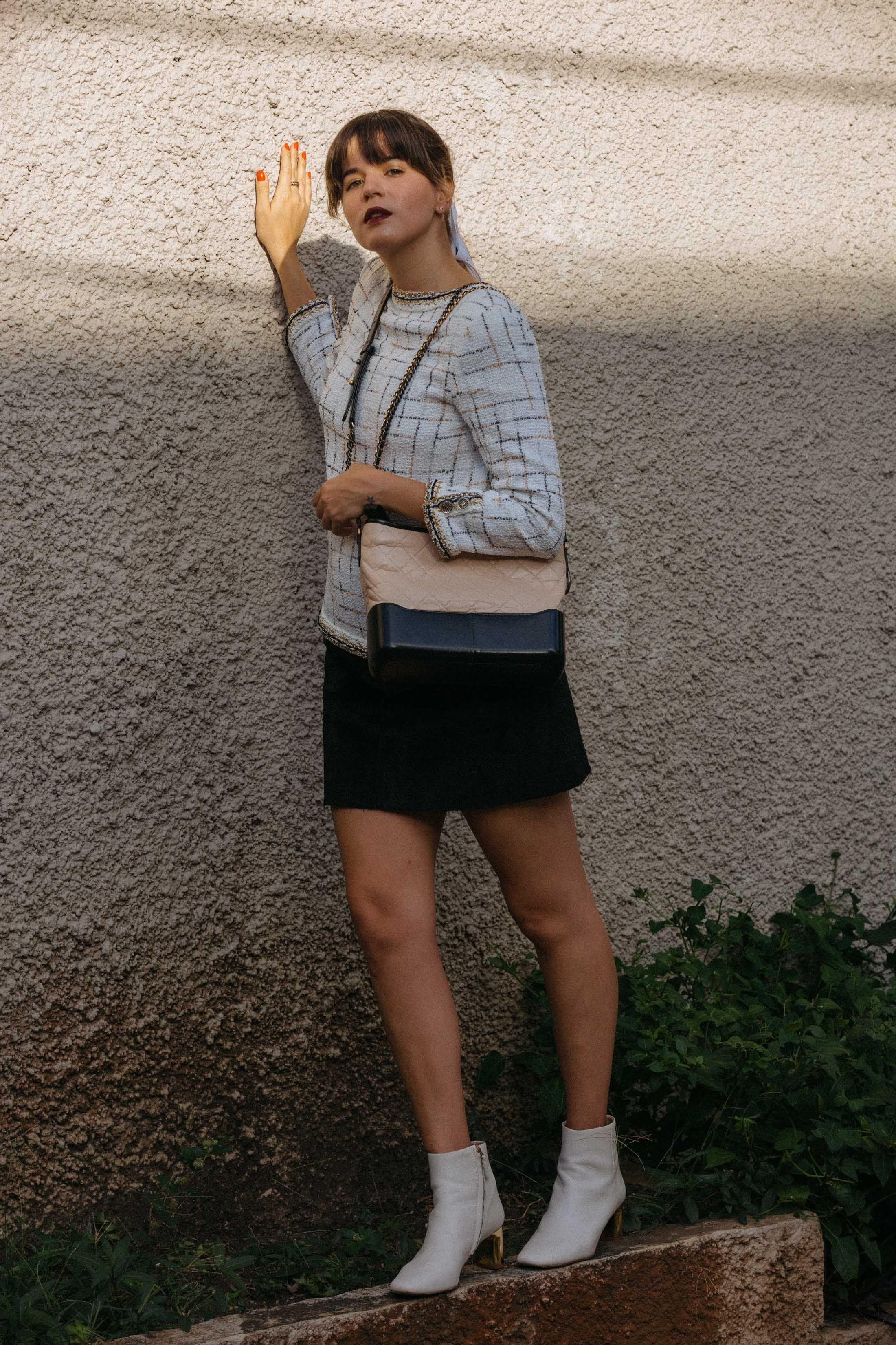 f6b716a910 Maristella wears the Chanel tweed jacket backwards