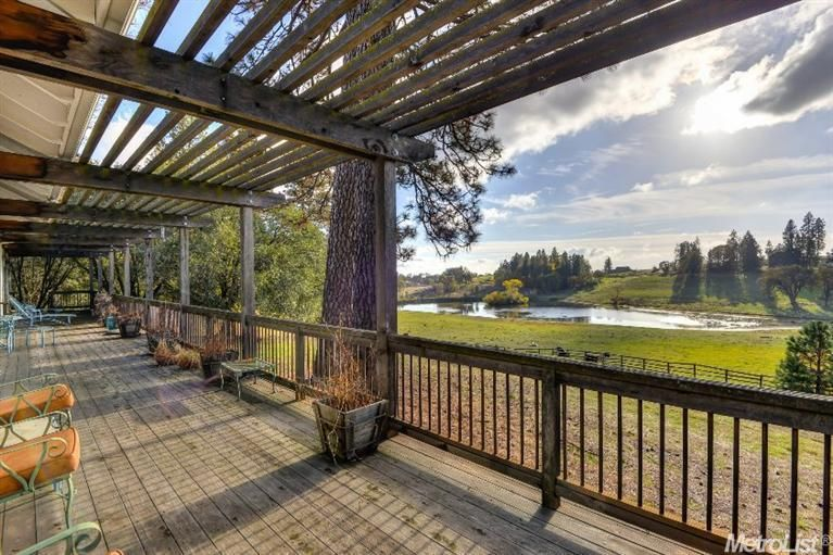 5260  Andy Wolf Rd,  Garden Valley, CA  95633.  These views are one of a kind! This serenely quiet, valley with a private lake just steps away...