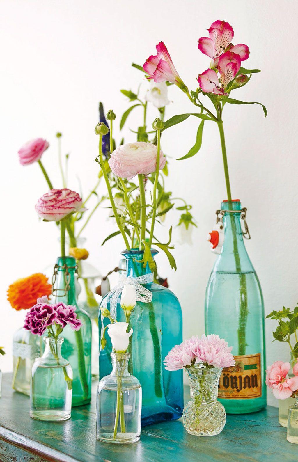 Flowers in blue glass bottles so pretty pinterest for Flowers in glass bottles