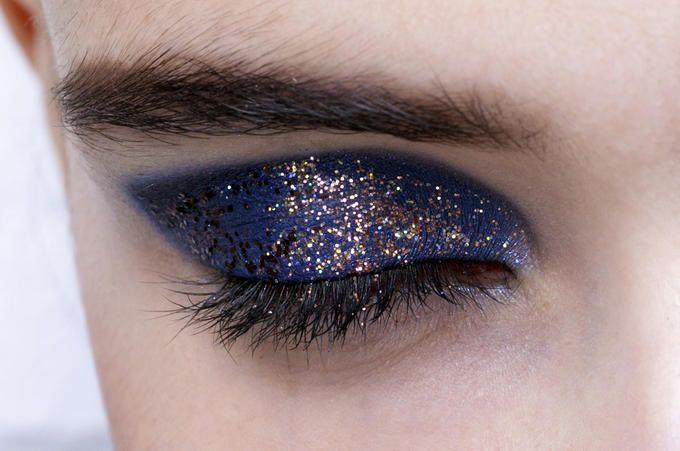Blue eye makeup with golden glitter