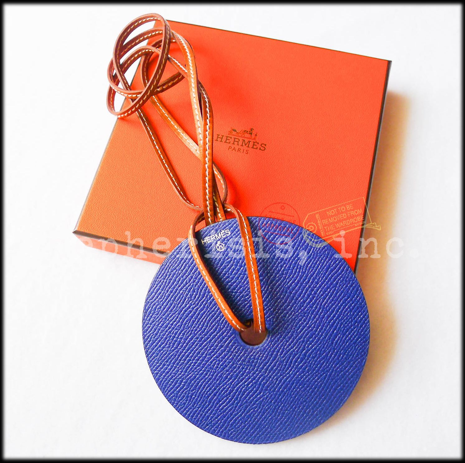 Hermes large round reversible leather pendant necklace. Blue electric/red. New condition with Hermes box & ribbon.