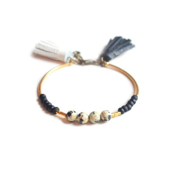 This beaded stacking bracelet is handmade with matte black Czech seed beads gold plated brass tube beads and spotted dalmatian jasper beads. The