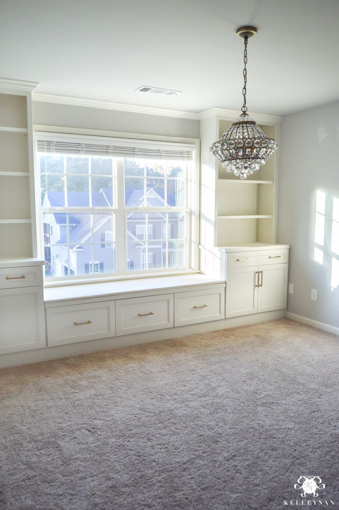 Crystal Chandelier in the center of the home office with built-ins around window images