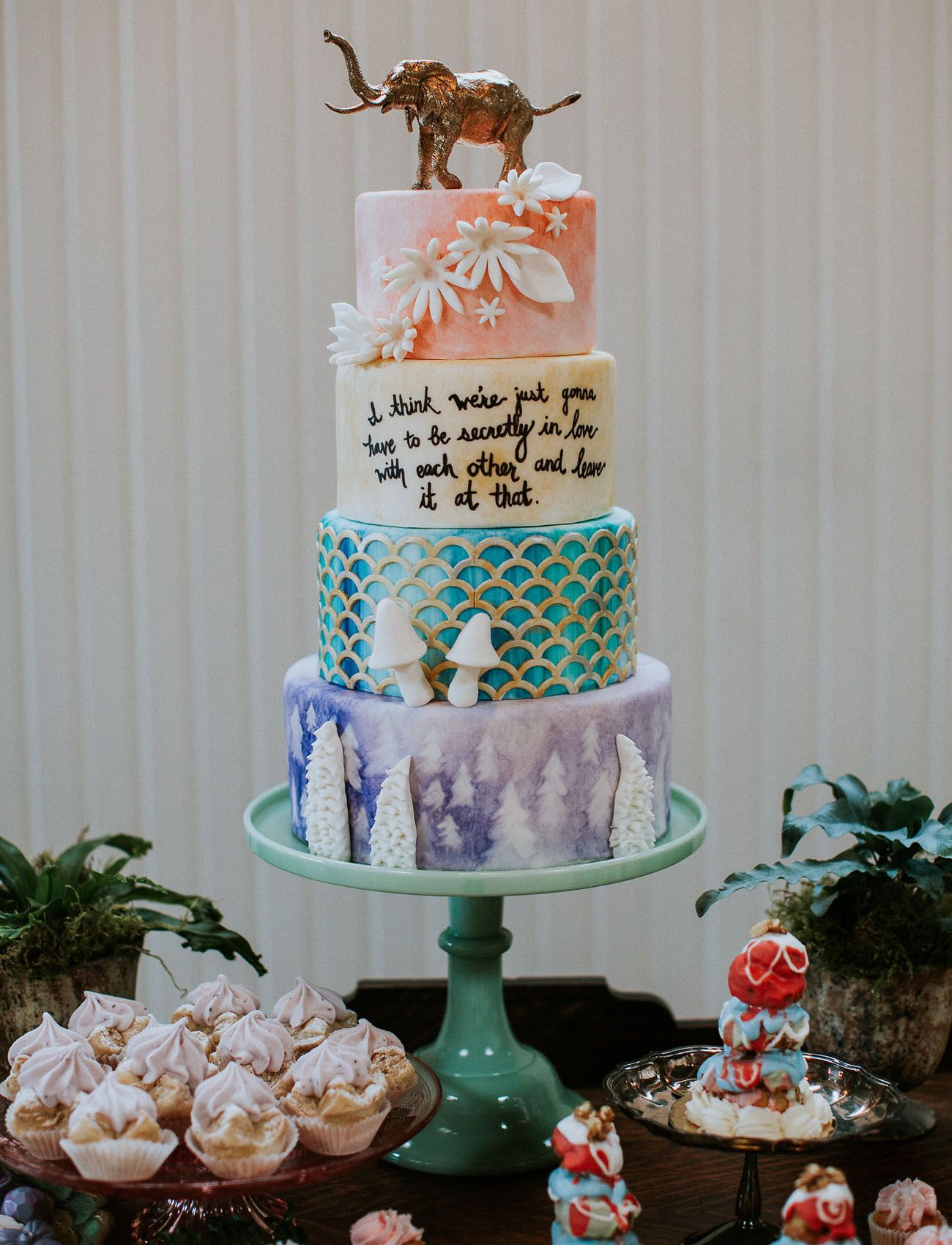 Wes Anderson woodland watercolor cake