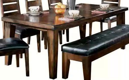 """Dark Brown Dining Room Extension Table by Famous Brand Furniture. $685.80. Inches: 42"""" W x 90"""" D x 30.25"""" H. Large table legs.. Made with select veneers and hardwood solids.. Rich burnished dark brown wood finish.. Matching pieces available.. Made with select veneers and hardwood solids. Rich burnished dark brown wood finish. Planked and framed construction table tops have thick built-up edge. Massive table legs have a two-sided taper shape."""