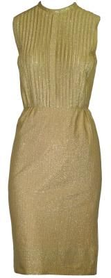 A beautiful 1960's gold shift dress. The dress is sleeveless and has a high round neckline. The front of the dress is pleated from the neck to the waist and a 53cm zip fastens up the back with a hook and eye on the neck. The dress cinches in at the waist with a think belt loop on either side. The skirt hugs the hips to the knee. This dress is in excellent condition. #Dress #Gold #1960 #Fashion #Party #Vintage
