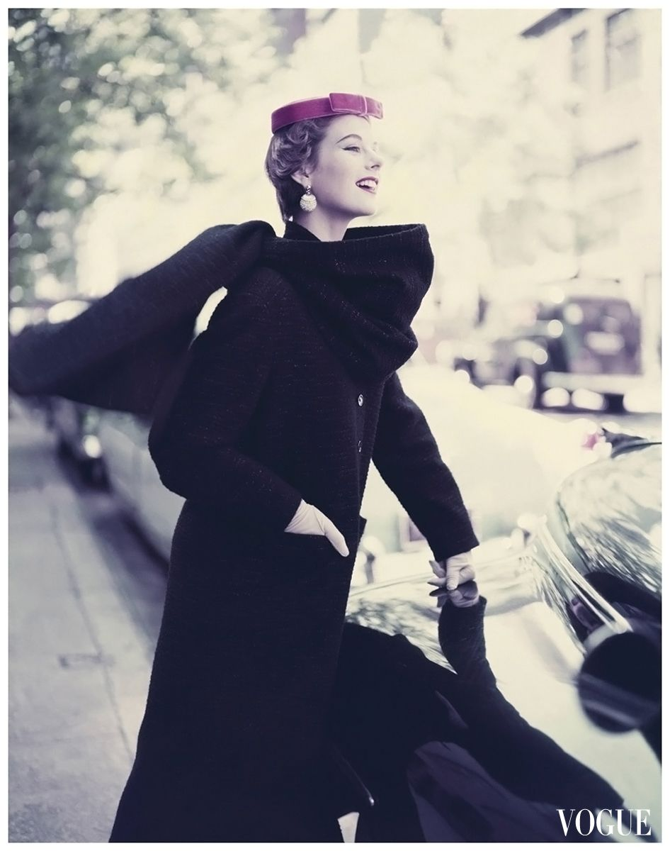 Vogue 1953, Model wearing narrow long wool woven black coat with a stole and tambourine hat. Photo by Roger Prigent.