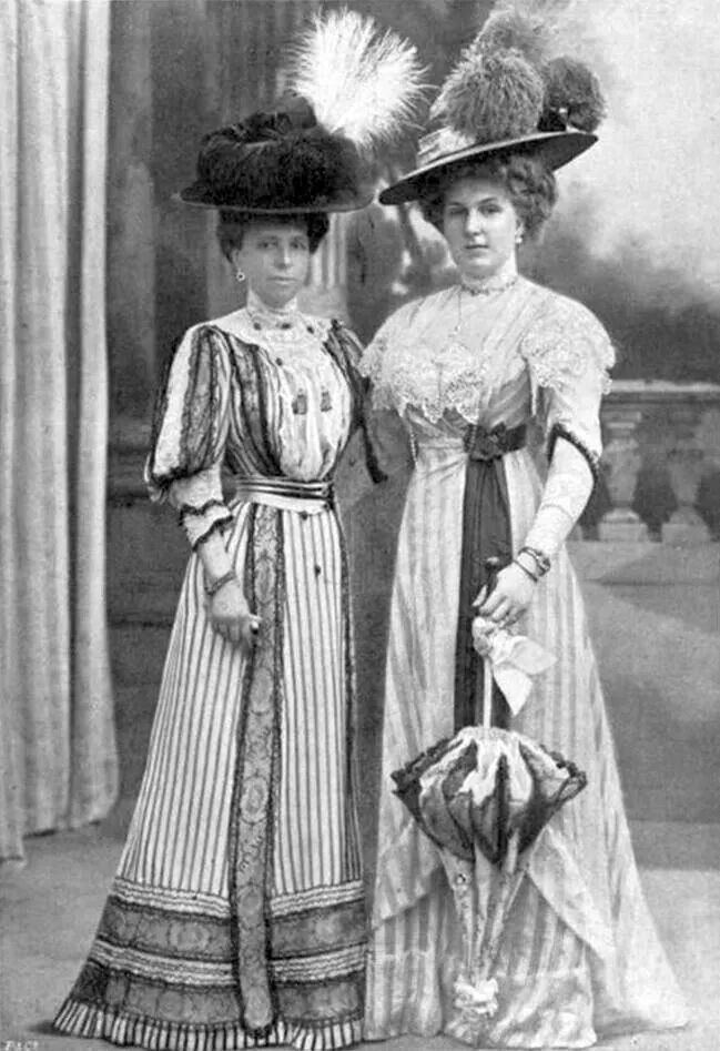 two edwardian women dressed