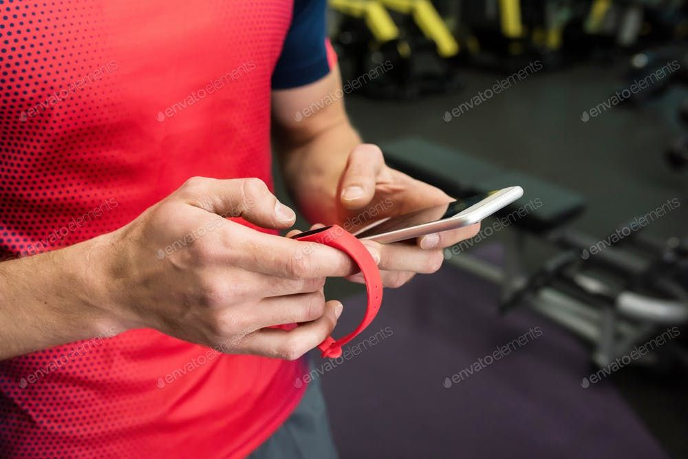 Sportsman using Fitness Device in Gym By seventyfourimages¡¯s photos #Ad , #sponsored, #Fitness, #Sp...