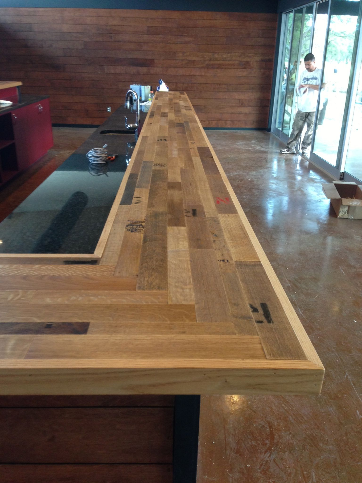 Cooperage bar made of recycled wine barrel staves creates