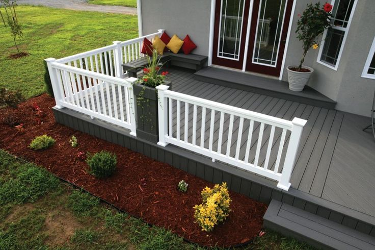 Gray deck with white fence and corner bench completed by for White composite decking
